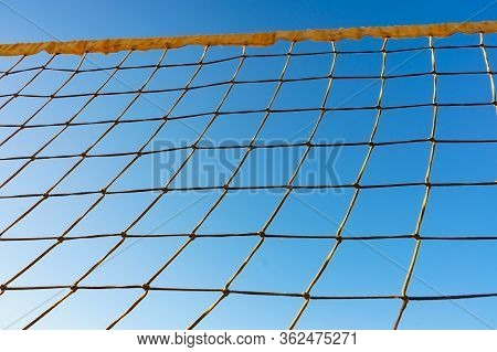 Volleyball Summer Sport Equipment. Net Netting Wire Against Blue Sky. Active Lifestyle.
