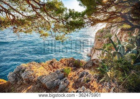 Beautiful Sunset Above Adriatic Sea And Coastline In Makarska. Location: Makarska Riviera, Dalmatia,