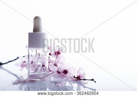 Hyaluronic Acid With Flowers On A White Background
