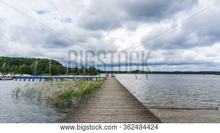 Jetty With Sailboats At The Lake Of Rheinsberg