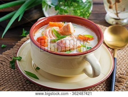 Kalakeitto. Creamy Soup With Salmon, Potatoes, Onions And Carrots And  In A Bowl. Finnish/ Karelian