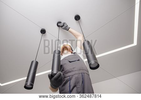 Electrician Worker Installation Electric Lamps Light Inside Apartment. Construction Decoration Conce