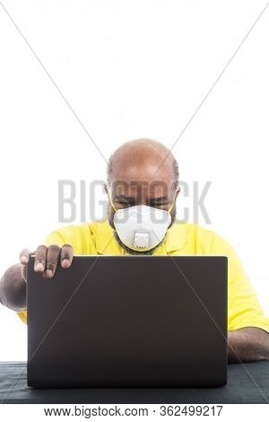 African American Man With Medical Mask On Laptop Computer. Concept Of Lockdown, Flatten The Curve, S