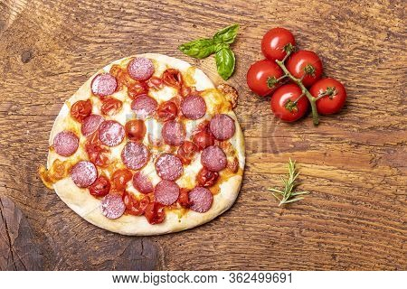 Overview Of A Salami Pizza On Wood