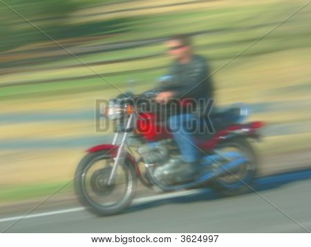 Motorcycle Speeding By