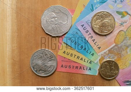 Close Up Picture Of Australian Banknotes And Coins On A Wooden Table. Currency And Money From Austra
