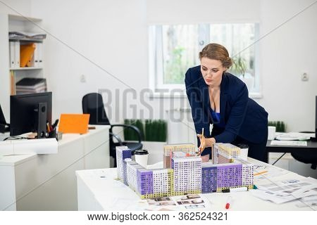 A Female Construction Bureau Employee Working On A Project