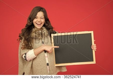 Just Look Here. Happy Girl Hold Empty Blackboard. Copy Space. Write Your Information Here. Place For
