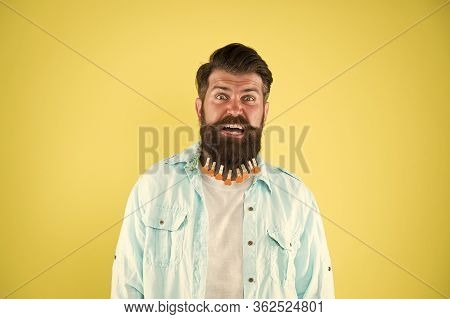 Man Clothespin On Beard. Brutal Hipster With Clothespin With Hearts. Bearded Man Casual Style Yellow