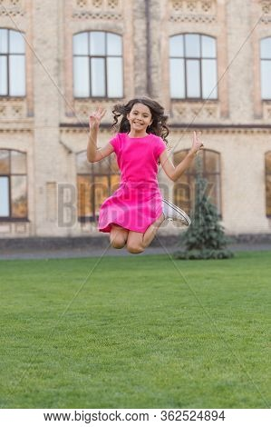 Feel Free. Jump Of Happiness. Small Girl Jump On Green Grass. Full Of Energy. Active Girl Feel Freed