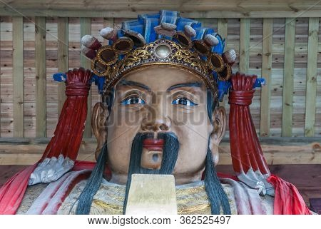 Fengdu, China - May 8, 2010: Ghost City, Historic Sanctuary. Head Closeup Of Colorfully Dressed Ance