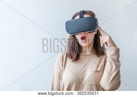Smile Young Woman Wearing Using Virtual Reality Vr Glasses Helmet Headset On White Background. Smart