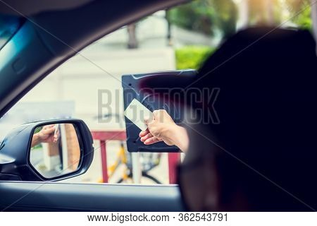 Selective Focus To Driver Hold Card To Scan At Card Reader Station For Open The Car Park Door.
