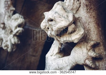Fierce Dragon Sculpture Guarding And Ancient Castle Portal. Detail Of Head, Mouth And Claws