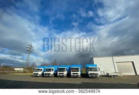 Berlin, Germany - Jan 18, 2020: Ultra Wide Angle Of Multiple Mercedes-benz Atego Trucks Next To Man