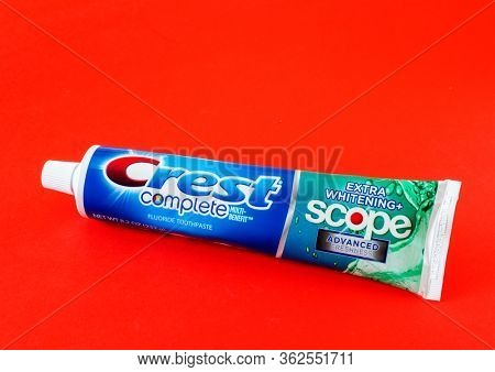 MOSCOW, RUSSIA - APRIL 20, 2020: Toothpaste Crest on a red background. Illustrative Editorial Photo