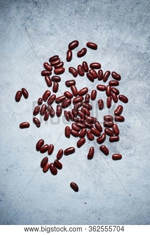 Red haricot beans on a stone table.