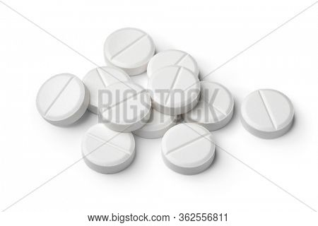 Heap of round white medicine tablets isolated on white background