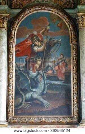 LIJEVI STEFANKI, CROATIA - JULY 10, 2011: Saint George slaying the dragon, the altarpiece in the chapel of St. George in the Lijevi Stefanki, Croatia