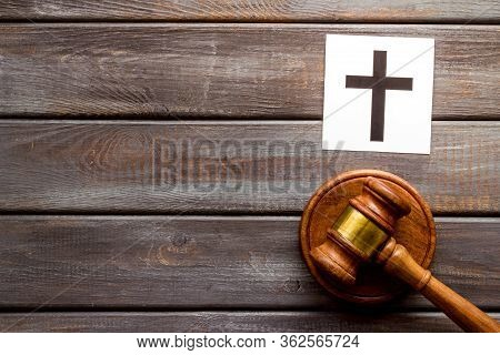 Catholic Cross - Catholicism Religion Concept - Near Gavel On Wooden Background Top View. Religious