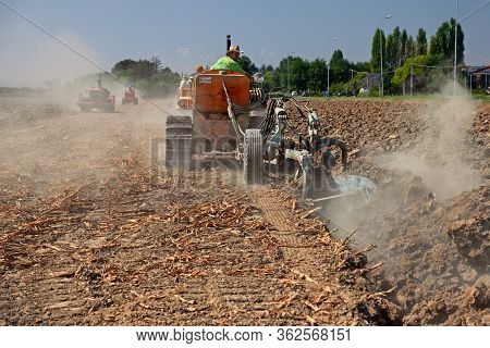 Farmer Plowing The Field With An Old Crawler Tractor And The Plow During The Country Fair Rombi Agri