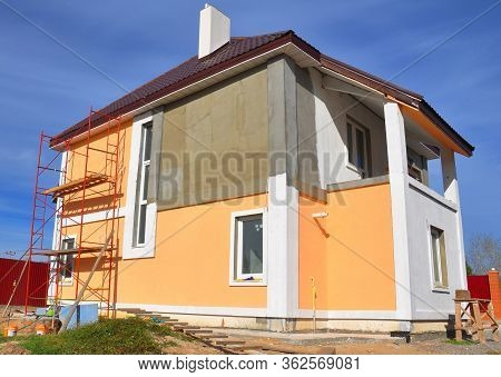 Painting Renovation A Modern House With Stucco House Finish, Stucco Siding And Metal Roof Using Scaf
