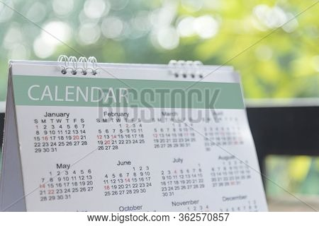 2019 Calendar Event Planner. Close Up On Calendar On Desk With Bokeh And Sun Light As A Background W