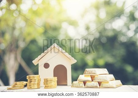 Real Estate Valuation Saving Money Concept. Woman Hand Go Down On Budget To Buy House Real Estate Ag