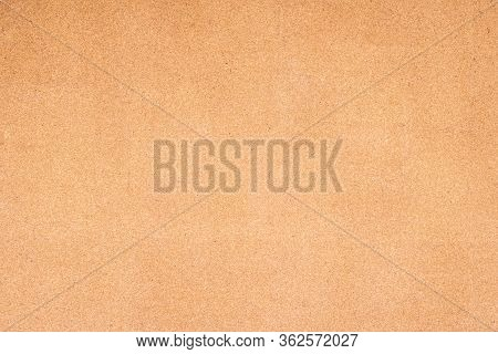 The Image Of Brown Cork Board Grunge Surface. A Noticeboard For Stick A Message For Communication Or