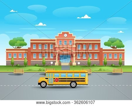 School On A Summer Day With A Green Lawn And Two Trees. A School Yellow Bus Is Standing In Front Of