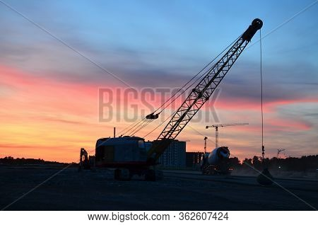 Crawler Crane With A Heavy Metal Wrecking Ball On A Steel Cable. Wrecking Balls At Construction Site