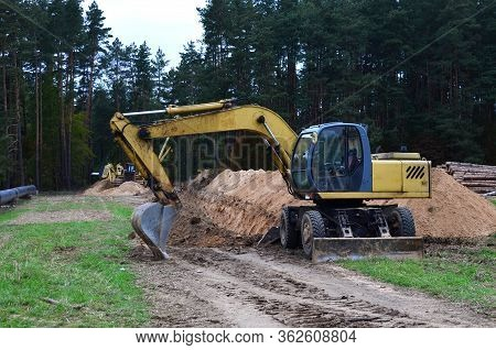 Excavator Digs Ground For The Installation Of Industrial Gas And Oil Pipes. Natural Gas Pipeline Con