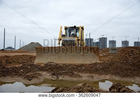 Track-type Dozer For Pool Excavation And Utility Trenching. Bulldozer During Land Clearing And Found