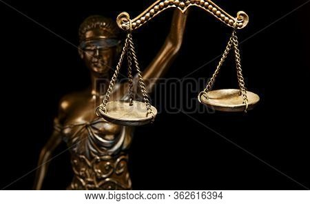 Bronze Themis Statue - Symbol Of Justice - Isolated On Black - Focus And Light On The Scales