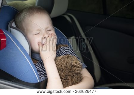 The Child Was Rocked In A Car Seat. The Boy Suffers From Kinetosis And Motion Sickness. The Concept