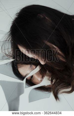 Empty Girl With Broken Mirror.