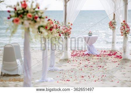 Romantic Wedding Ceremony On The Beach. Wedding Setting On The Beach. Flowers Wedding Ceremony By Th