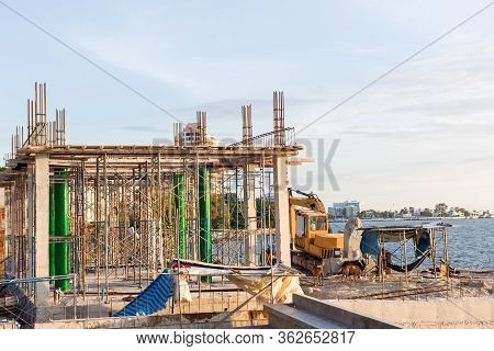 A New Stick Built Home Under Construction. Construction Residential New House In Progress At Buildin