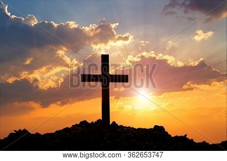 Cross On Mountain Sunset Background. Easter Concept. Concept Conceptual Black Cross Religion Symbol