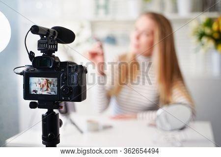 Display Of Camera Recording Video Blog For Blonde Beauty Blogger Woman With Make-up At Home Studio.