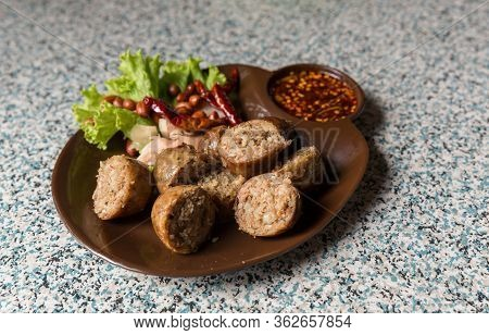 Sausage Small Circles On The Grid-iron Grill With Smoke Over Charcoal. Thai Sausage, Fermented Rice