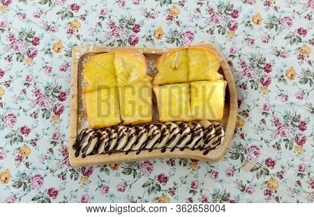 Toast With Sweetened Condensed Milk And Chocolate Powder On Top. Bread Toast With Butter And Condens