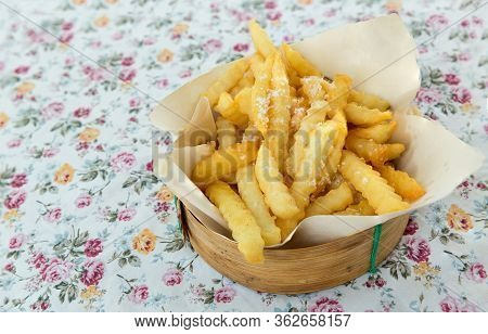 Fried French Fries On A Plate On The Wooden Table. Yummy French Fries As Background. French Fries In