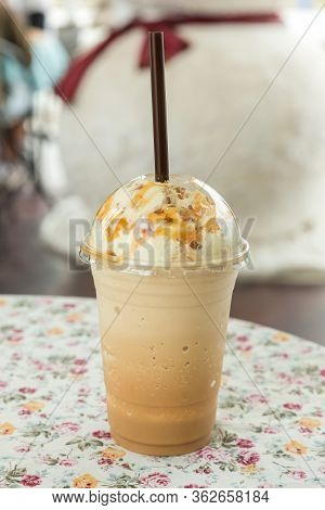 Ice Coffee With Cream On Table. Caramel Frappe Coffee In The Coffee Shop. Iced Blended Frappucino. F