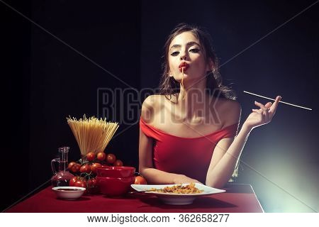 Italian Woman In Eats Spaghetti Pasta. Woman Cooked Spaghetti. Italian Food And Menu Concept. Woman