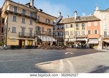 View Of The Market Square Or Piazza Del Mercato With Medieval Buildings, Domodossola, Italy