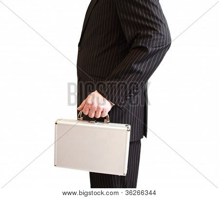 Businessman in black suit holding a white suitcase