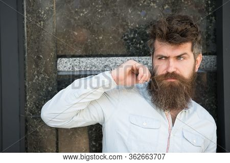 Man With Beard And Mustache On Concentrated Face, Black Marble Background. Masculinity Concept. Hips