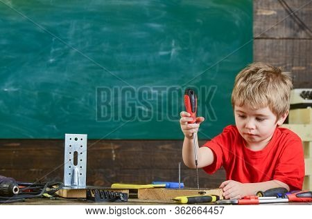 Kid Binding Screw To Board. Cute Boy Using Screwdriver. Educational Game Concept