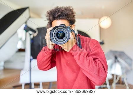 Professional photographer taking pictures with SLR camera